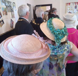 Hats and chains of office a plenty as the procession assembles in the church hall.