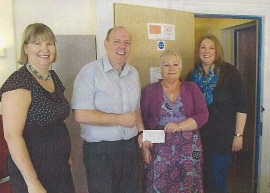 Joanna, Olive & Stephnie receive a cheque from Barrie Funnell of Eagle Radio Trust
