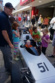 Children enjoying a racing car in Princess Way