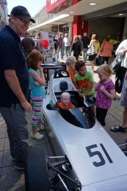 Children enjoying a racing car in Princess Way