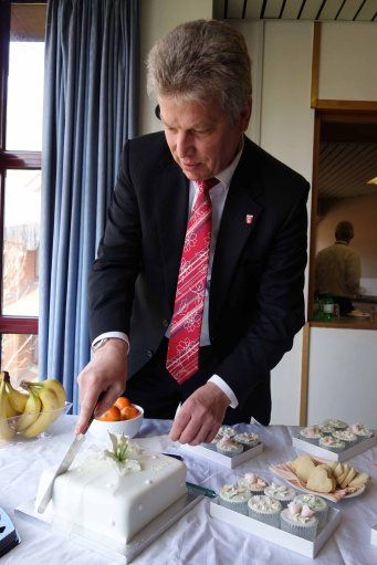 Mayor of Bietigheim-Bissingen Jürgen Kessing, cuts his birthday cake