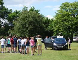 1-Youngsters queing for a driving lesson