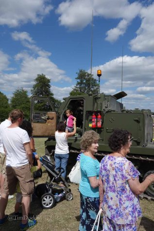 15-The very young enjoy military vehicles