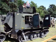 14-Kids love clambouring over military vehicles