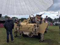 15-Kids love clambouring over military vehicles