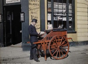 a-postman-delivers-packages-with-his-parcel-post-barrow-in-front-of-a-shop-in-oxford-offering-haircutting-and-shaving-in-1928_1