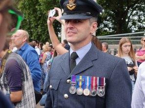 2-Standing next to a serviceman