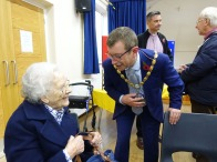 5a-The Mayor thanks a poppy knitter